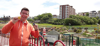 Richard with a pair of hole-in-one prize badges at Championship Adventure Golf in New Brighton