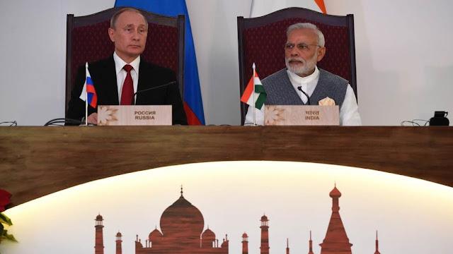 Russian President Vladimir Putin hosts Indian premier Narendra Modi at Russia's economic showcase