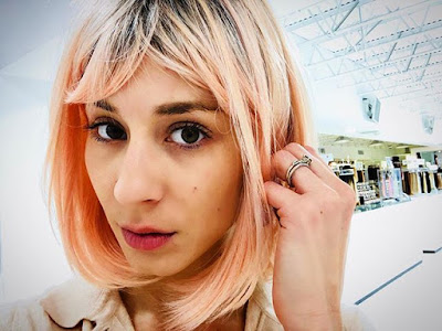 Troian Bellisario's Peach Rose Gold Bob Hairstyle with Bangs