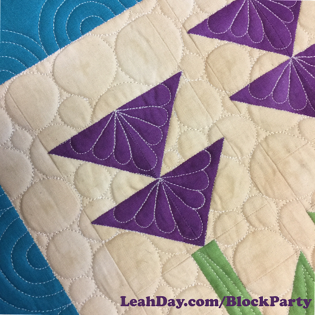 How to quilt a flower quilt block