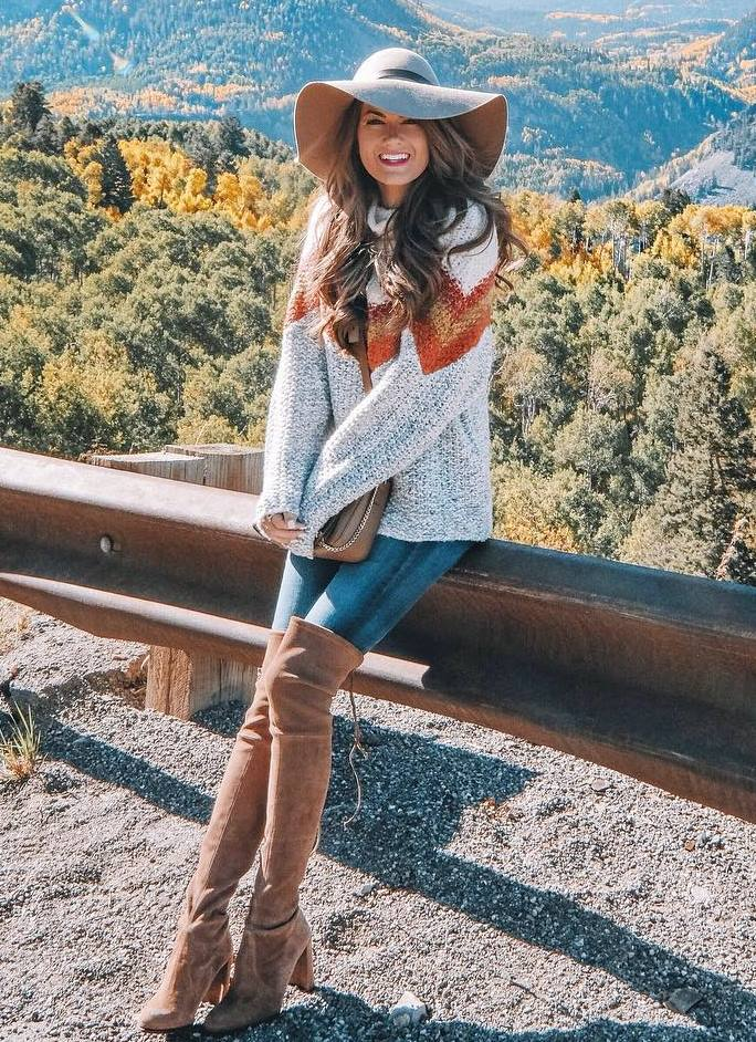 how to style a hat : knit sweater + skinny jeans + over knee boots + bag