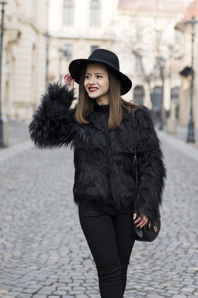 how to wear the black faux fur jacket