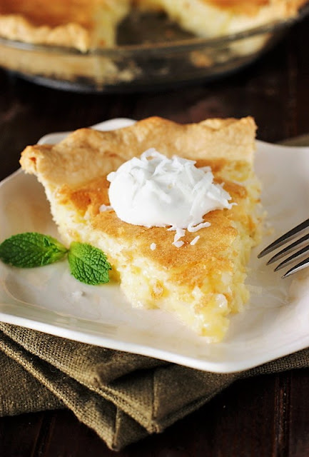 Coconut Custard Pie Image ~ coconut deliciousness surrounded in moist-and-creamy, melt-in-your-mouth vanilla custard.  And that is coconut goodness that just can't be beat!