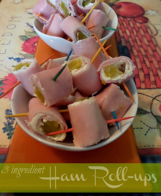 Party appetizers made with ham, pickles, and cream cheese with toothpicks