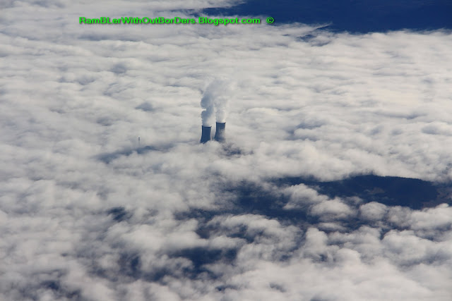 Aerial view of chimneys above the clouds over northern Spain from the windows of a commercial airline