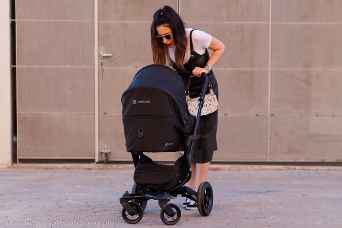 Look con Vestido de cuero para pasear con Vera y su cochecito de bebé Neo Mobility Set de Concord