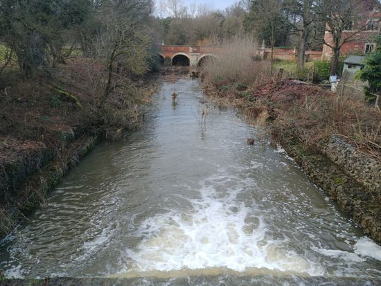 A similar view on December 29, 2017 with the River Colne in full flow  Image by the North Mymms History Project, released under Creative Commons