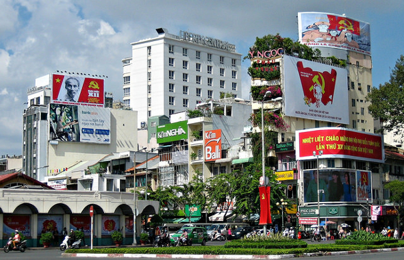 Image Attribute: Vietnam 2016 12th Party Congress, posters and signs everywhere. This image is of Ben Thanh Traffic Circle in Ho Chi Minh City. / Source: Picture taken 17 January, 2016. Prince Roy under a Creative Commons Licence