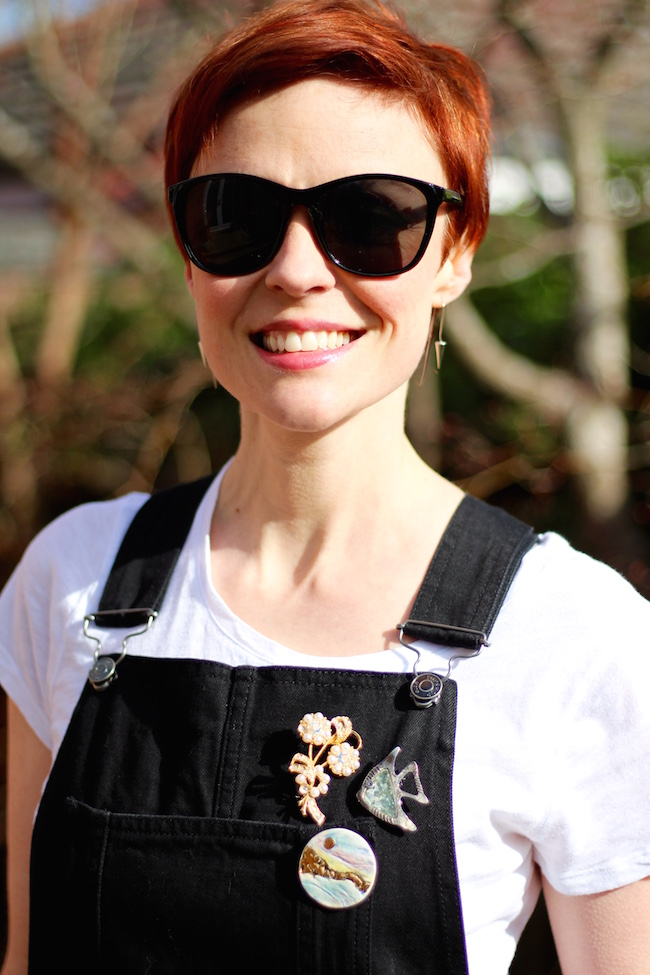 Fake Fabulous | Wearing dungarees, with vintage brooches, over 40.