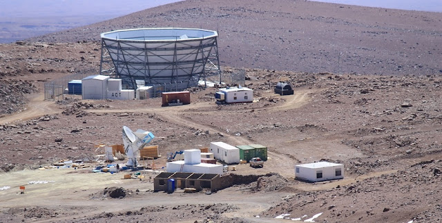 The Simons Observatory will combine the 6-meter Atacama Cosmology Telescope (shown in the background) with several 3.5-meter telescopes similar to the Huan Tran Telescope (shown in the foreground). Credit: Brian Keating