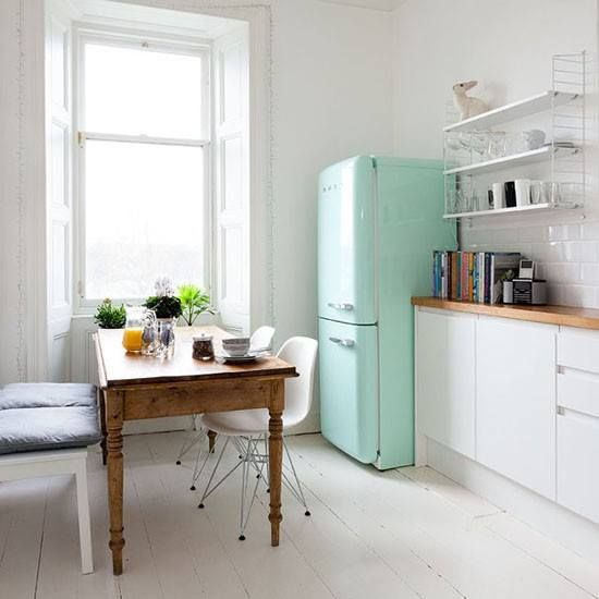Mint green smeg pops in this bright and white kitchen