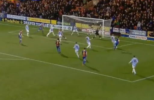 Wilfried Zaha scores to give Crystal Palace the lead against Huddersfield