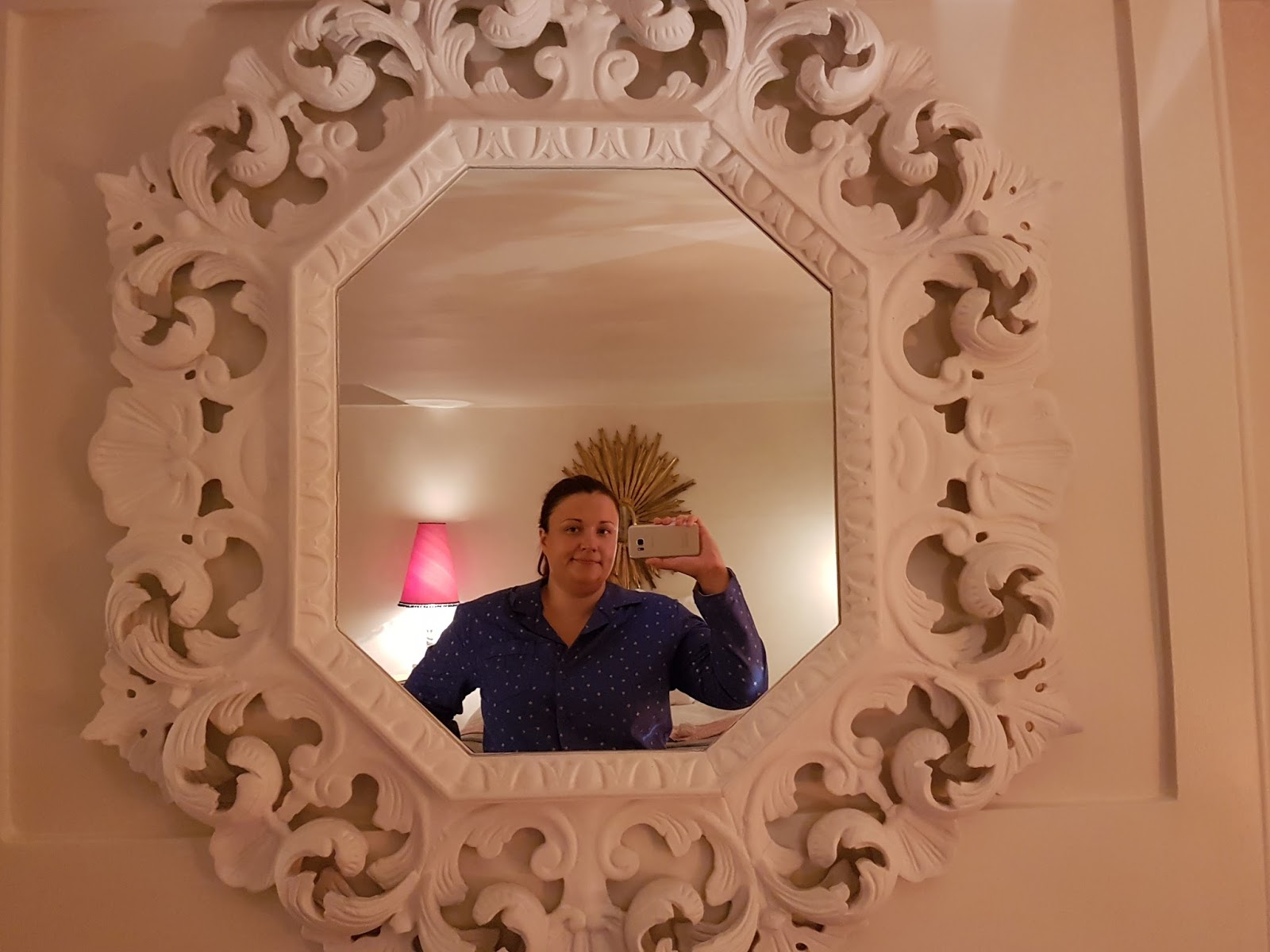 woman taking a selfie through a mirror