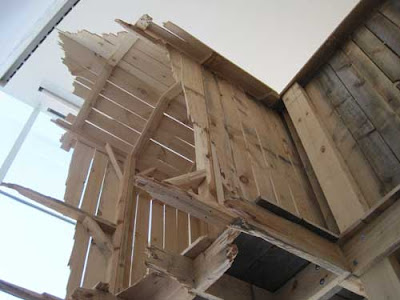 Upward show of Chris Larson's structure, showing ragged edges on the boards