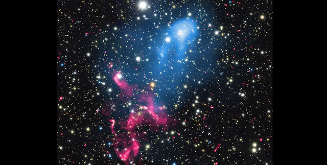 "Using data from NASA's Chandra X-ray Observatory and several other telescopes, astronomers have discovered a cosmic one-two punch unlike any ever seen in a pair of colliding galaxy clusters called Abell 3411 and Abell 3412. This composite image contains X-rays from Chandra (blue) that reveals diffuse emission from multi-million-degree gas in the two clusters. The comet-shaped appearance of the hot gas provides clear evidence that the two clusters are colliding and merging. The ""head"" of the comet is hot gas from one cluster plowing through the hot gas of the other cluster. Credit: X-ray: NASA/CXC/SAO/R. van Weeren et al; Optical: NAOJ/Subaru; Radio: NCRA/TIFR/GMRT"