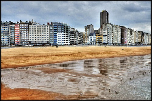 10 Best Places to Holiday in Belgium (100+ Photos) | Rainy day on the North Sea beach in Oostende, Belgium