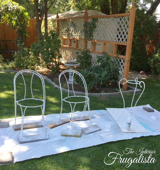 Metal bistro chairs and a candle holder unified with white Rust-oleum spray paint