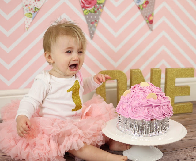crying baby at cake smash