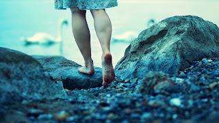 Woman walking around the lake