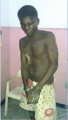 PHOTOS: Boutique burglar caught and beaten to a pulp in Delta State