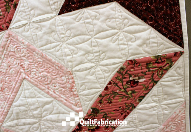 Joy quilt negative space design