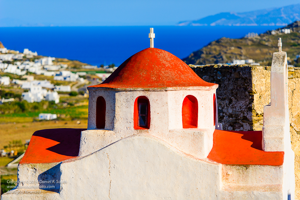 a photo of a red chapel on mikonos island greece