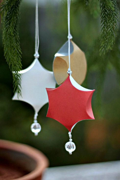 sculpted paper ornaments, red, gold, and silve
