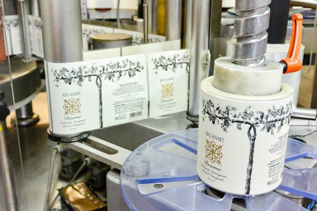 Recanati Winery - Lableling machine. Photo by Nicole Ruiz Hudson