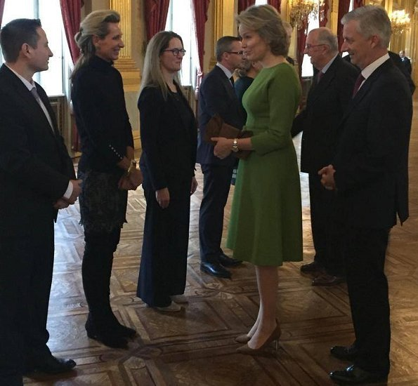 King Philippe, Queen Mathilde, King Albert and Prince Laurent at Combating Human Trafficking seminar. Natan dress