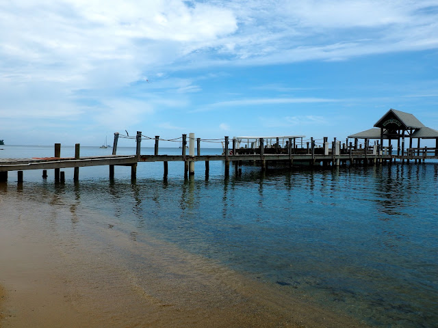 Wooden dock into the ocean on Roatan Island, Honduras