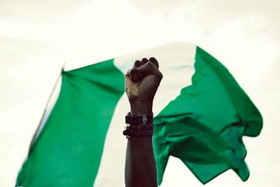 nigerian-flag-waving-celebration-democracy-day