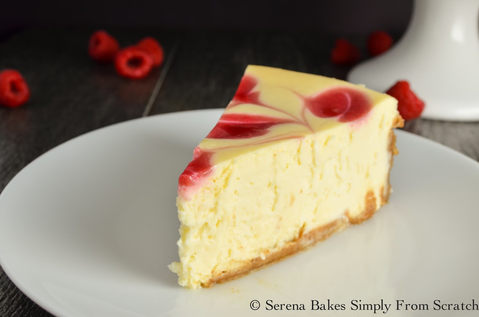 Tall Creamy Cheesecake with Raspberry Swirl.