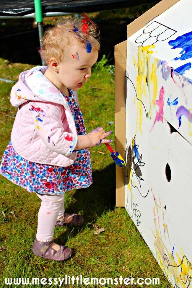 Painted cardboard playhouse. Fun outdoor art activities for kids.