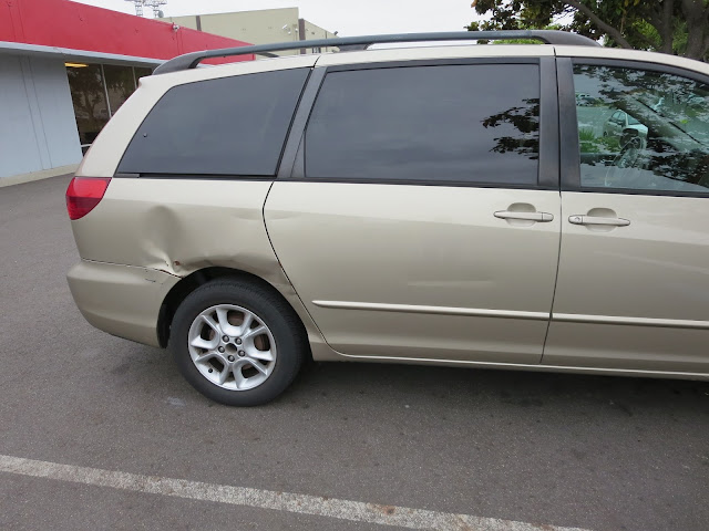 Big dents in side of Toyota Sienna before collision repair.