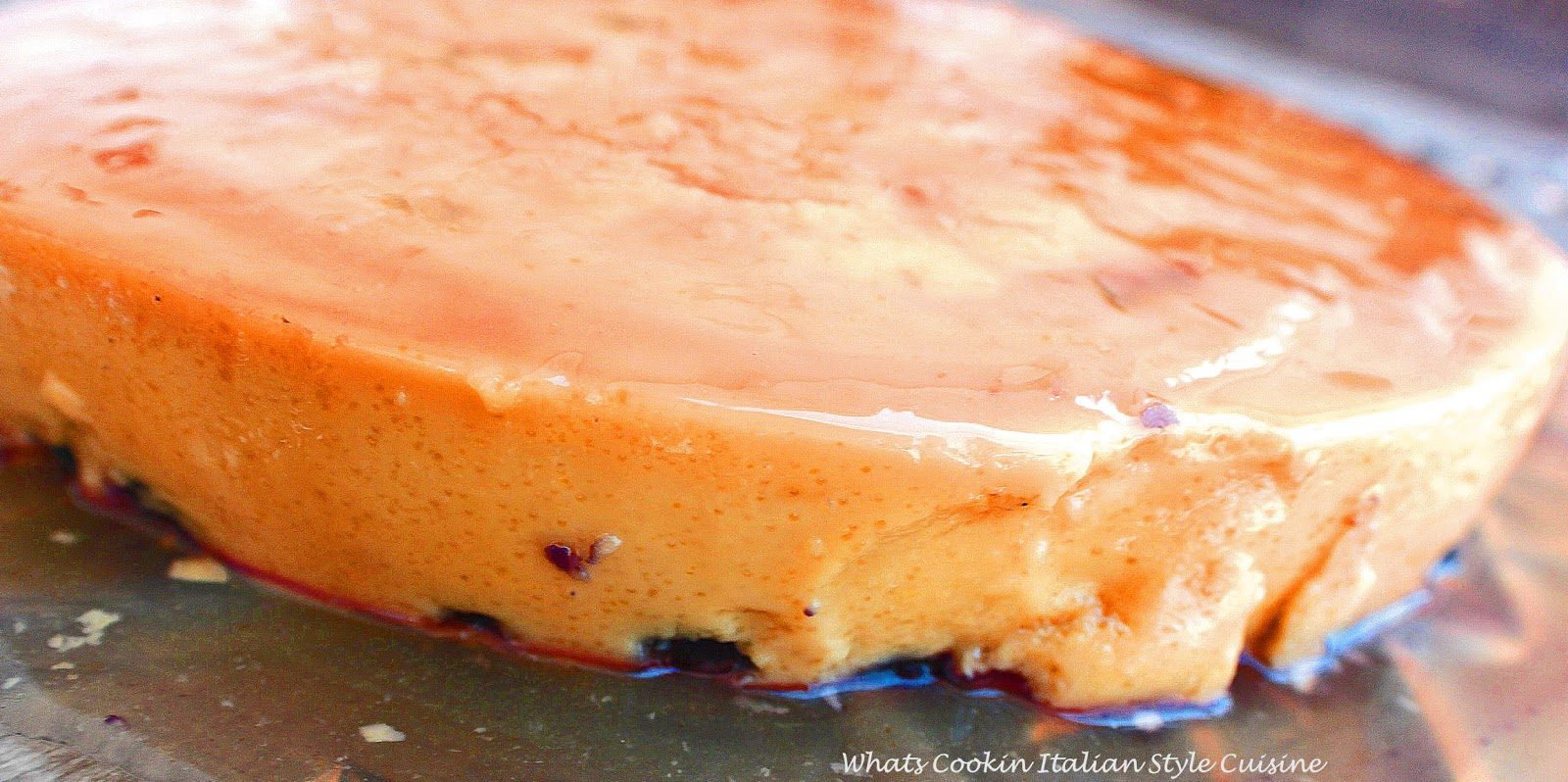 Flan is a Mexican custard baked in a water bath in the oven that creates a syrup in the pan. This is a blueberry flan with decadent custard filling dessert
