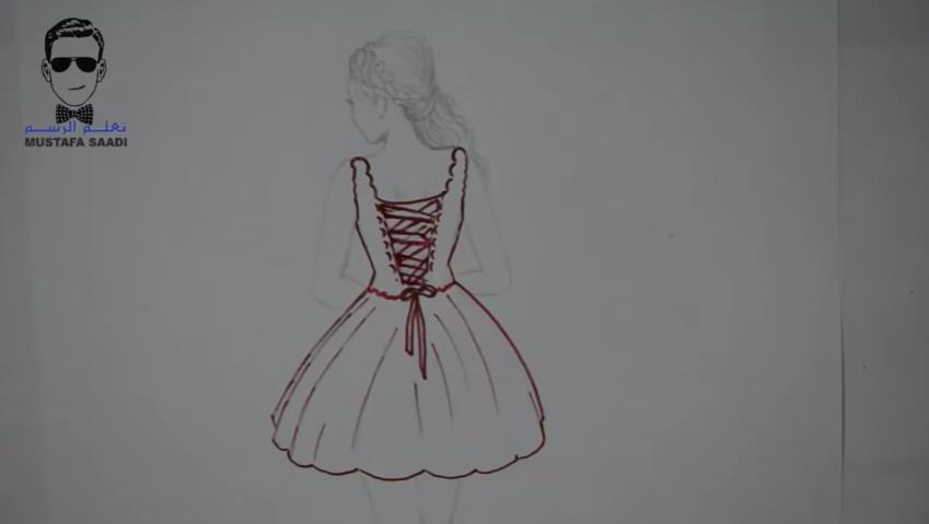 e007b3a54 5- بعد الانتهاء من المراحل السابقة نبدأ مباشرة في تلوين شكل الفستان بألوان  مناسبة حسب رغبتكم.