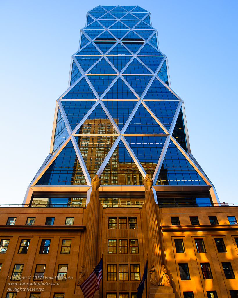 a photo of the hearst building in new york at the golden hour