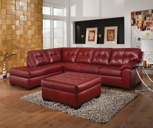 elegant red leather sectional sofa with small leather table completed with soft gray rug and brown brick wall