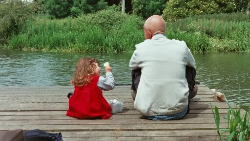 child and father by a river