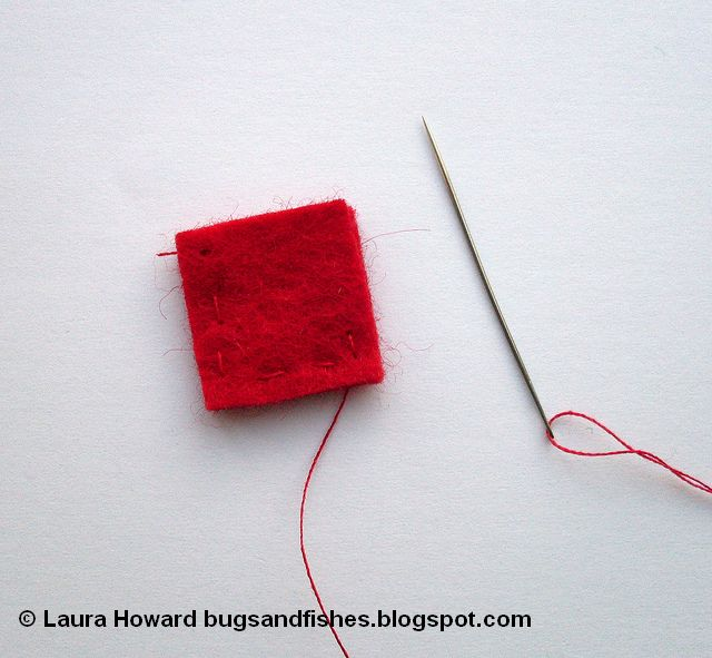 sewing the base of a felt Christmas tree ornament