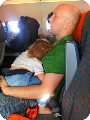 baby asleep on plane, baby on airplane