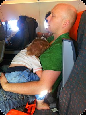 baby asleep on plane, baby on airplane