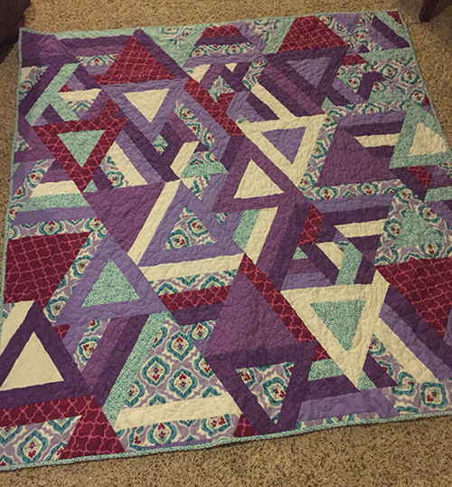Cozy Posy Triangle Quilt Pattern designed by Erica Jackman for Moda Bake Shop