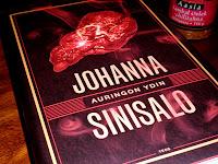 http://villasukkakirjahyllyssa.blogspot.fi/2013/10/johanna-sinisalo-auringon-ydin.html