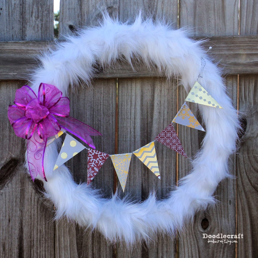 http://www.doodlecraftblog.com/2014/11/fur-wreath-decorated-with-dcwv-paper.html