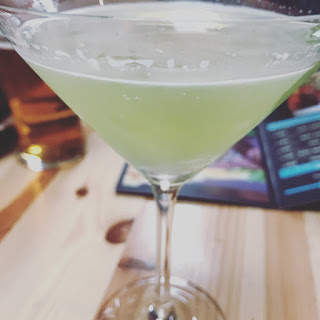 green cocktail on table