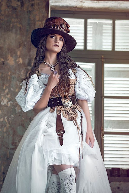 Steampunk clothing for bridal party/weddings. Steampunk wedding dress, corset, top hat, jewelry and belt.