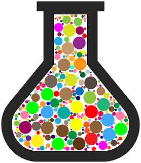 A diagram of a lab beaker on a white background, filled with coloured circles of various sizes and colours.