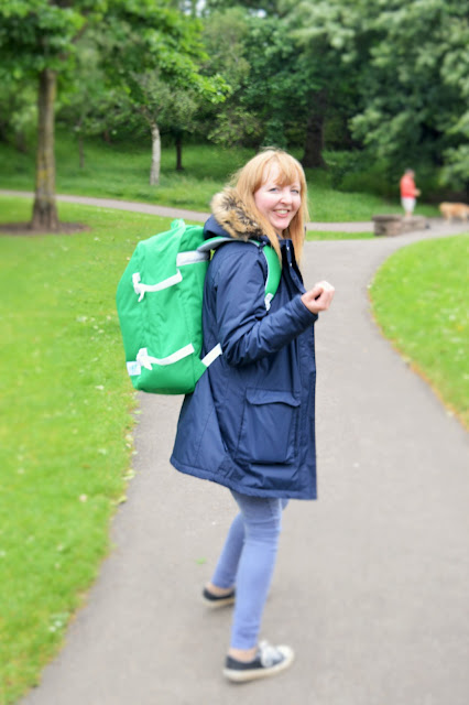 A woman with a green cabin zero bag on her back.