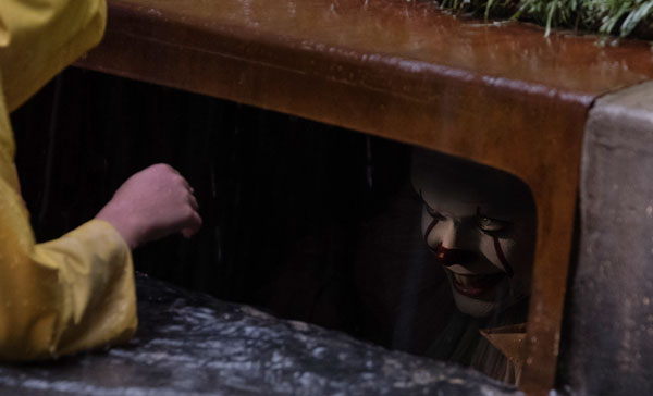 The opening scene involving Georgie (Jackson Robert Scott) encounters Pennywise (Bill Skargård) near the storm drain in IT (2017)